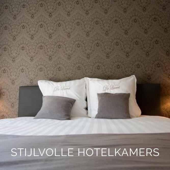 Realisatie stijlvolle hotelkamers behang arte
